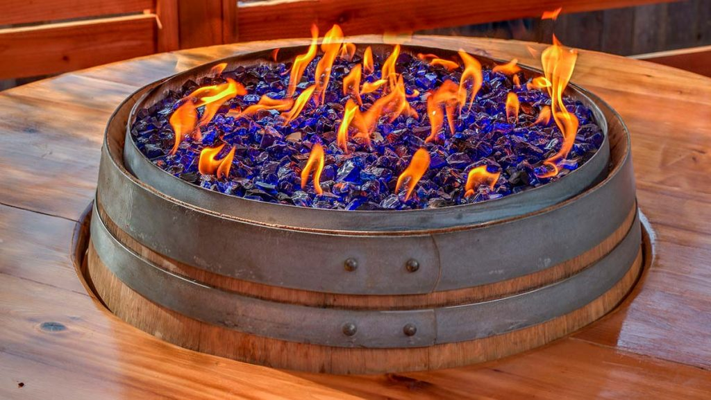Cobalt Blue Crushed Fire Glass in Wine Barrel Fire Pit